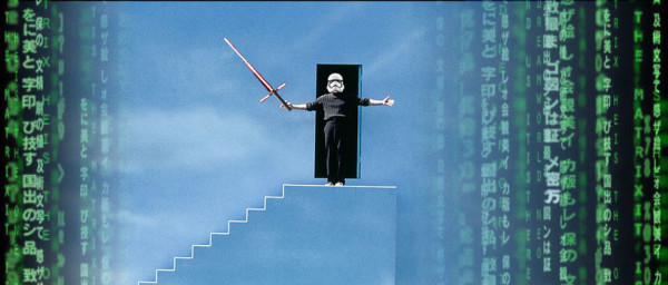 star trooper Truman show atop staircase with light sabre